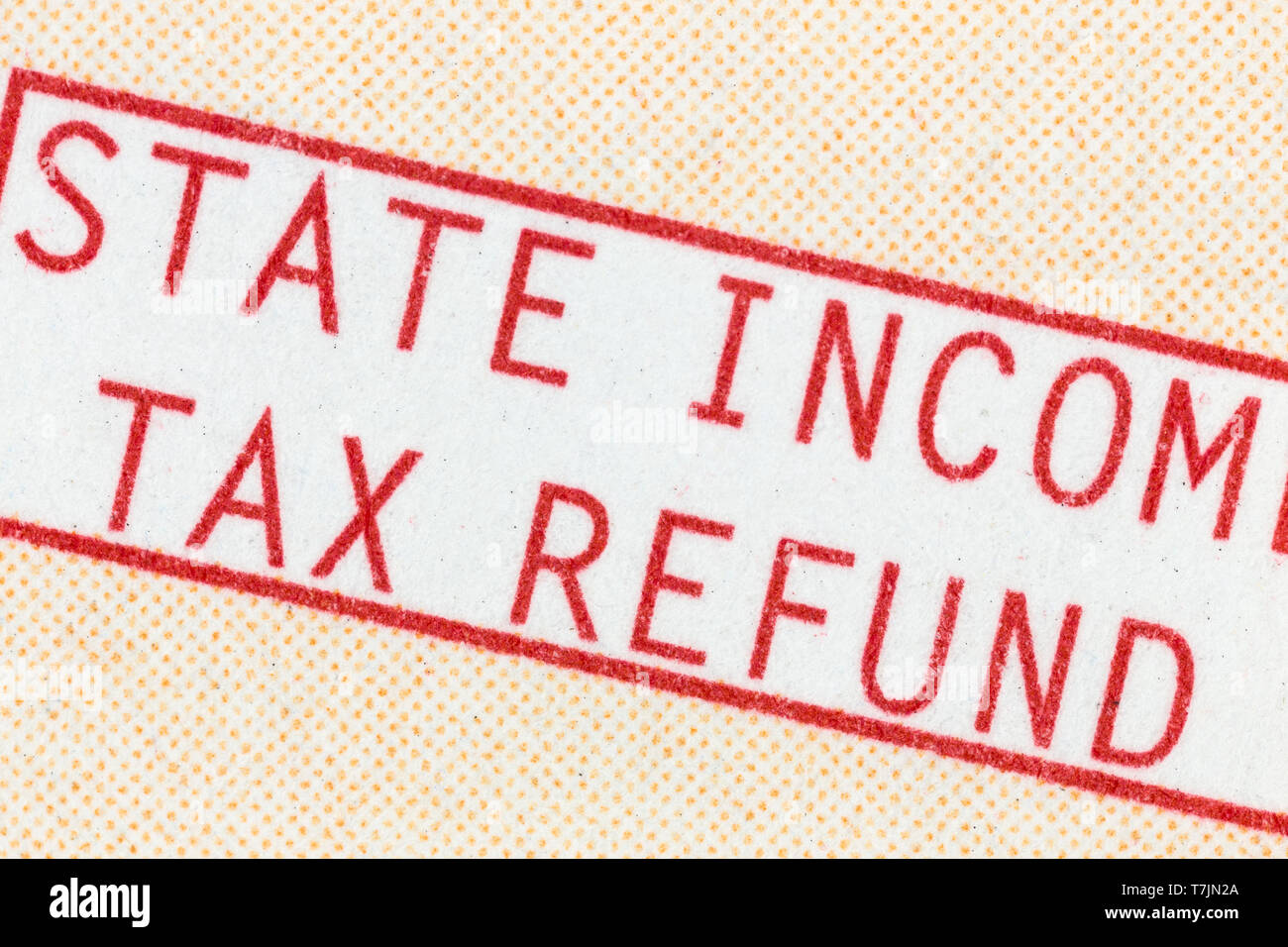 Macro detail of state income tax refund check paper statement text. - Stock Image