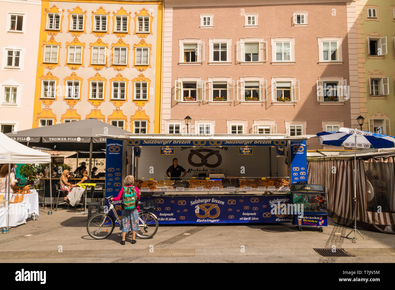 Salzburg, Austria - September 11, 2018: A market stall with different kinds of  pretzels (brezen) on the outdoor market at University  square - Stock Image
