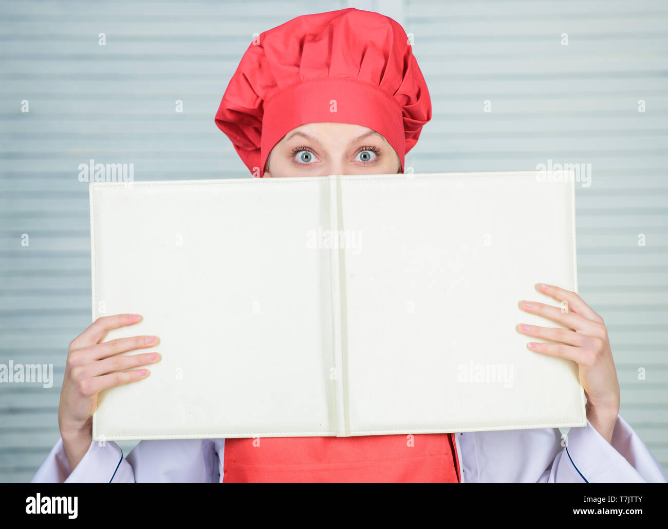 girl read big book of seating plan, copy space  cook in