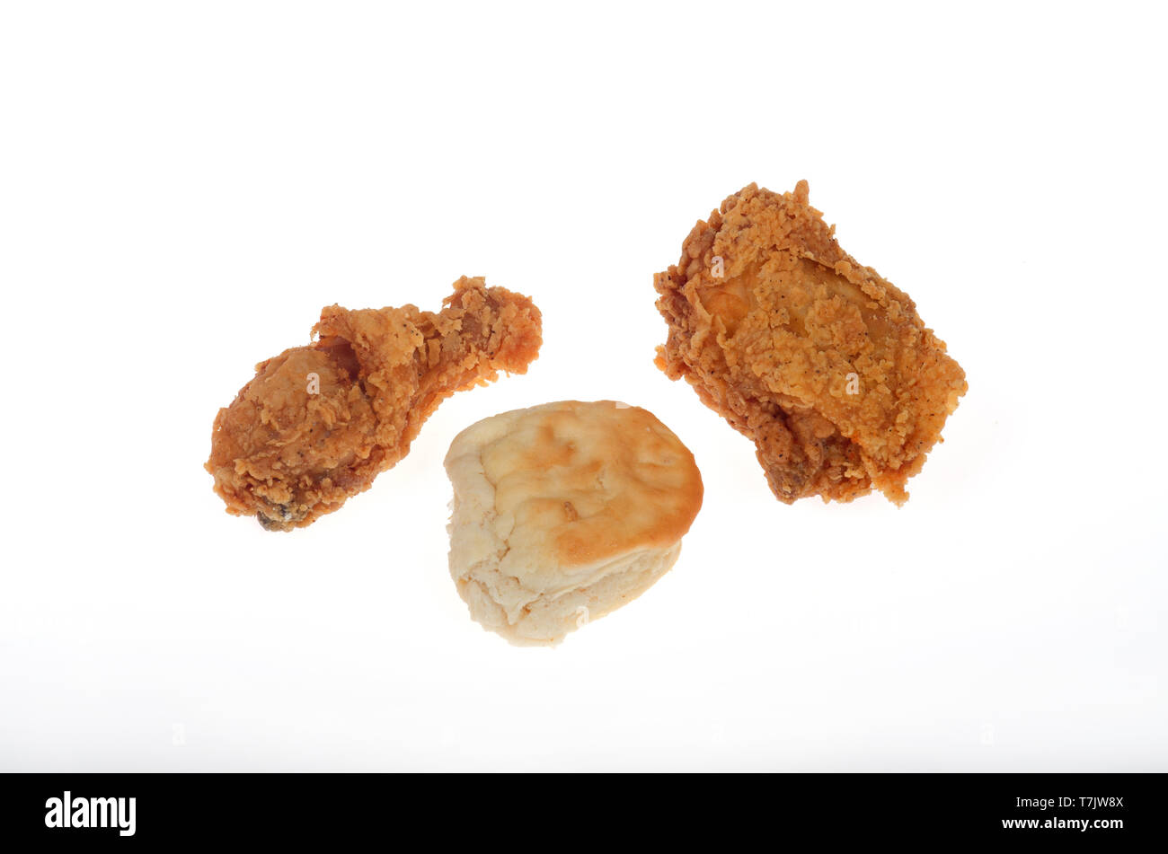 KFC crispy fried chicken drumstick, thigh and biscuit on white background - Stock Image