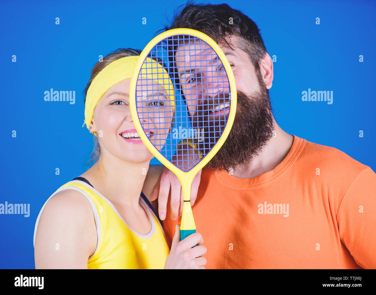 We are one. Athletic Success. Sport equipment. Happy woman and bearded man workout in gym. Strong body muscles. Sporty couple train with tennis racket. We know how to score. happy to train together. - Stock Image