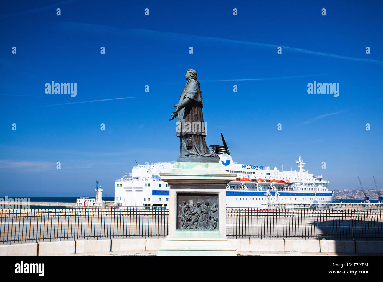Marseille, France - May 6, 2011: Statue and luxury boat next to Marseille Cathedral. It is a Roman Catholic cathedral, and a national monument of Fran Stock Photo