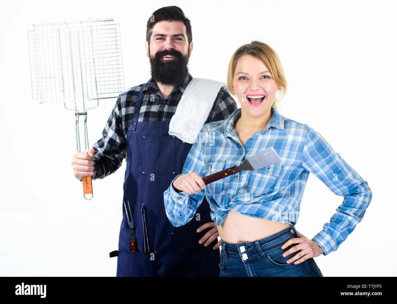 Family weekend. Picnic barbecue. food cooking recipe. Man bearded hipster and girl. Preparation and culinary. Couple in love hold kitchen utensils. Tools for roasting meat. Chill time with friends. - Stock Image