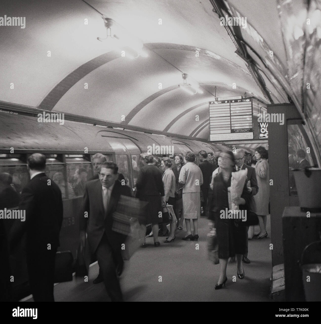 1960s, historical picture of London Underground, a tube train on the Bakerloo line at a platform, people getting on and off the train, London, England, UK. Opened in 1906, the Bakerloo line runs from north-west london to south london via the west end. - Stock Image