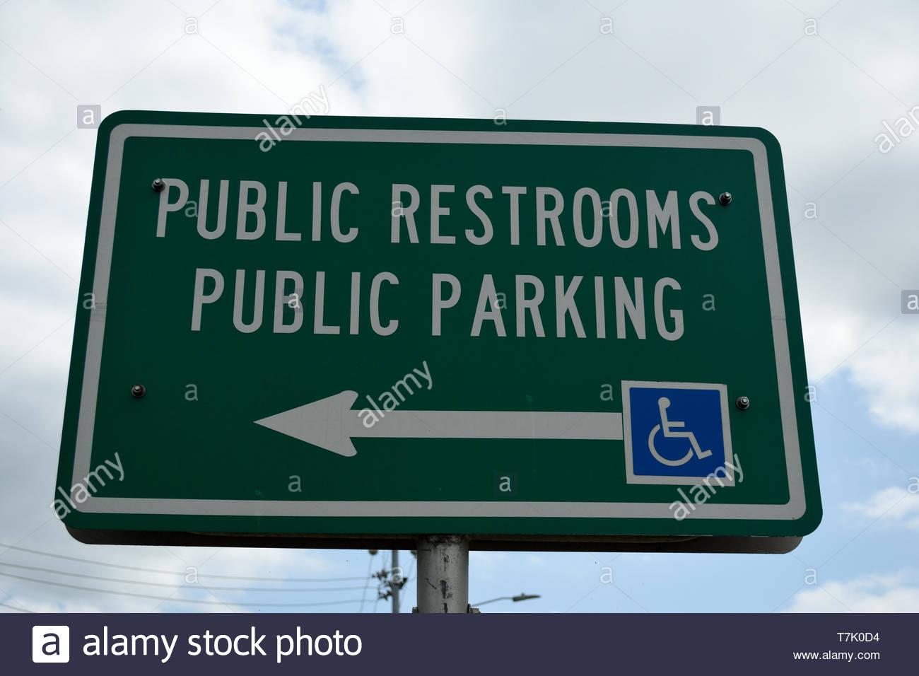 Public Restroom Sign. Public Parking Sign. Handicapped Sign. Sign With Arrow. Public Parking. Public Restrooms. Public Restrooms Public Parking Sign. - Stock Image