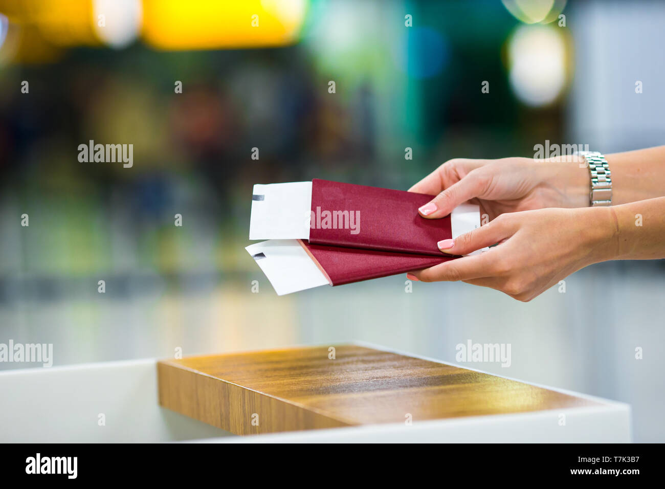 Closeup passports and boarding pass at the reception area in airport inside - Stock Image