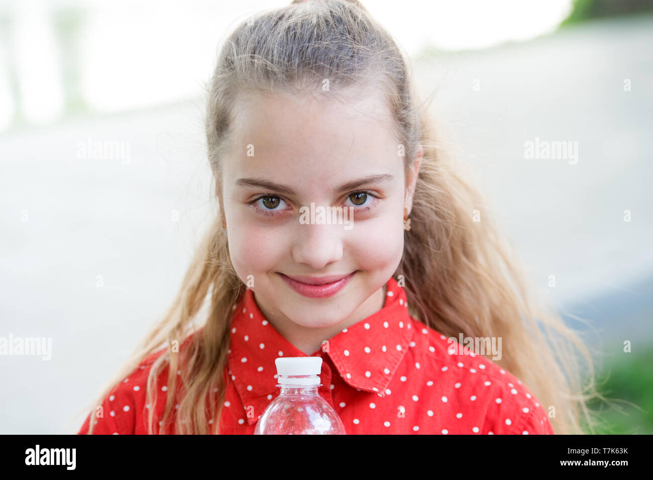 Make one more sip. Live healthy life. Healthy and hydrated. Girl care about health and water balance. Girl cute cheerful hold water bottle. Water balance concept. Drink water during summer walk. - Stock Image