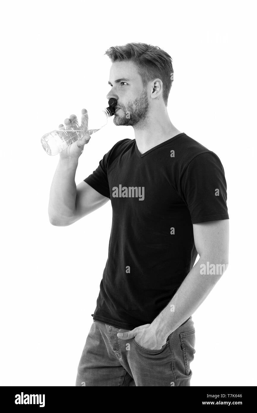 Feeling thirsty. Man athlete hold water bottle. Guy drink water on white background. Man care health and water balance. Sportsman care hydration water nourishment body. Healthy lifestyle concept. - Stock Image