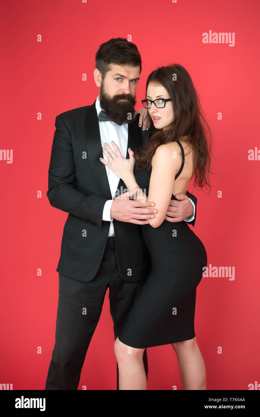 Elegance is not about being noticed. Bearded man wear suit girl elegant dress. Formal dress code. Visiting event or ceremony. Couple ready for award ceremony. Corporate party. Award ceremony concept. - Stock Image