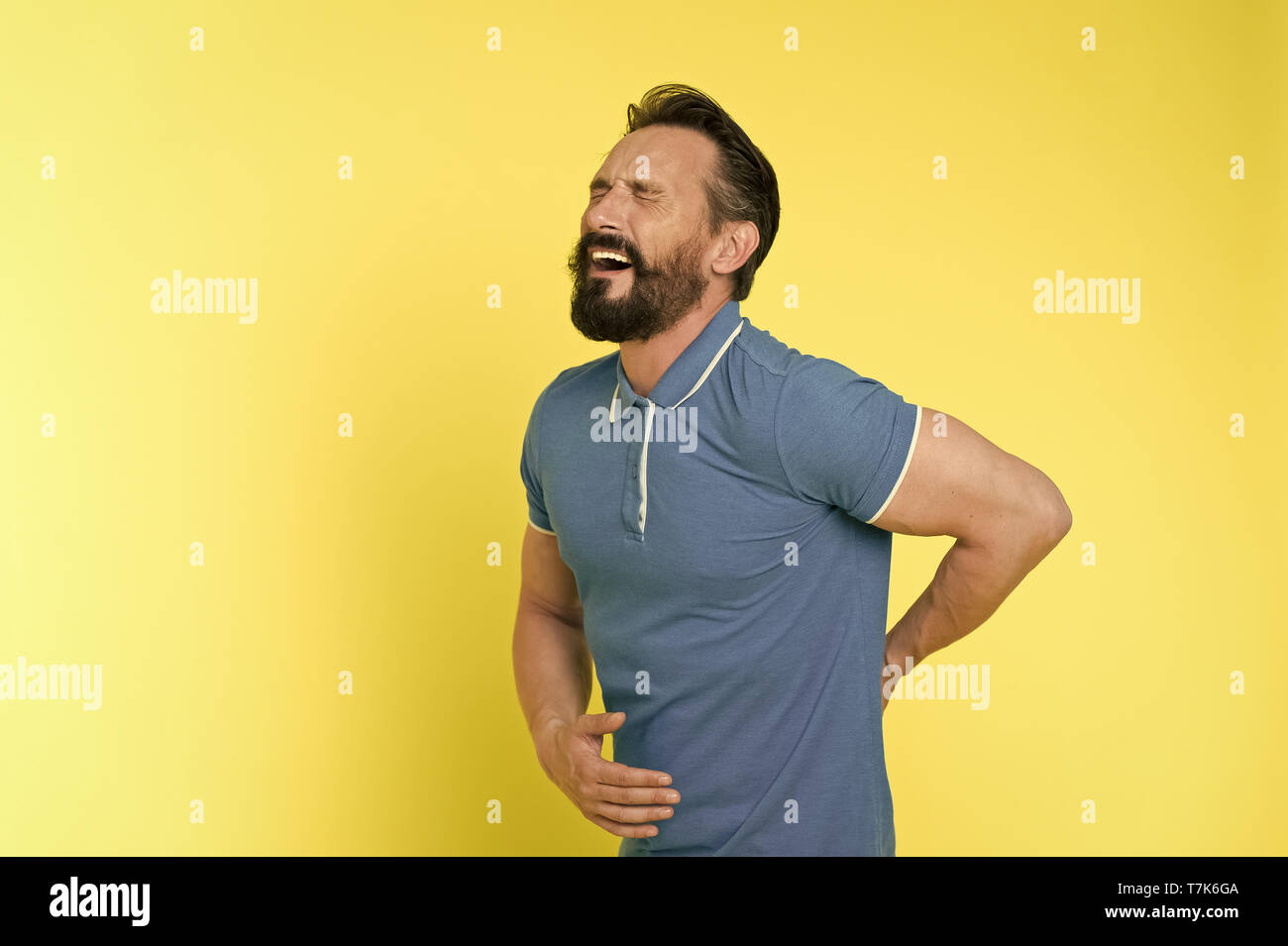 Pain concept. Senior man feel pain in back. Bearded man suffer from pain. I know real pain, copy space. - Stock Image