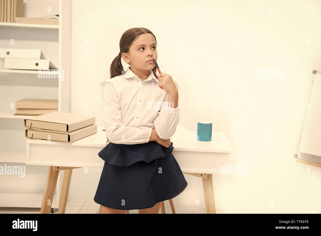Genius concept. Genius girl lost in thoughts. Genius child solve problem. Genius pupil back to school. Use your brain. - Stock Image