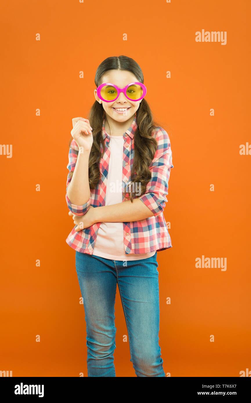 Sunglasses fancy accessory. Eyesight and eye health. Improve eyesight. Girl kid wear eyeglasses. Optics and eyesight treatment. Effective exercise eyes zooming. Child happy with good eyesight. - Stock Image