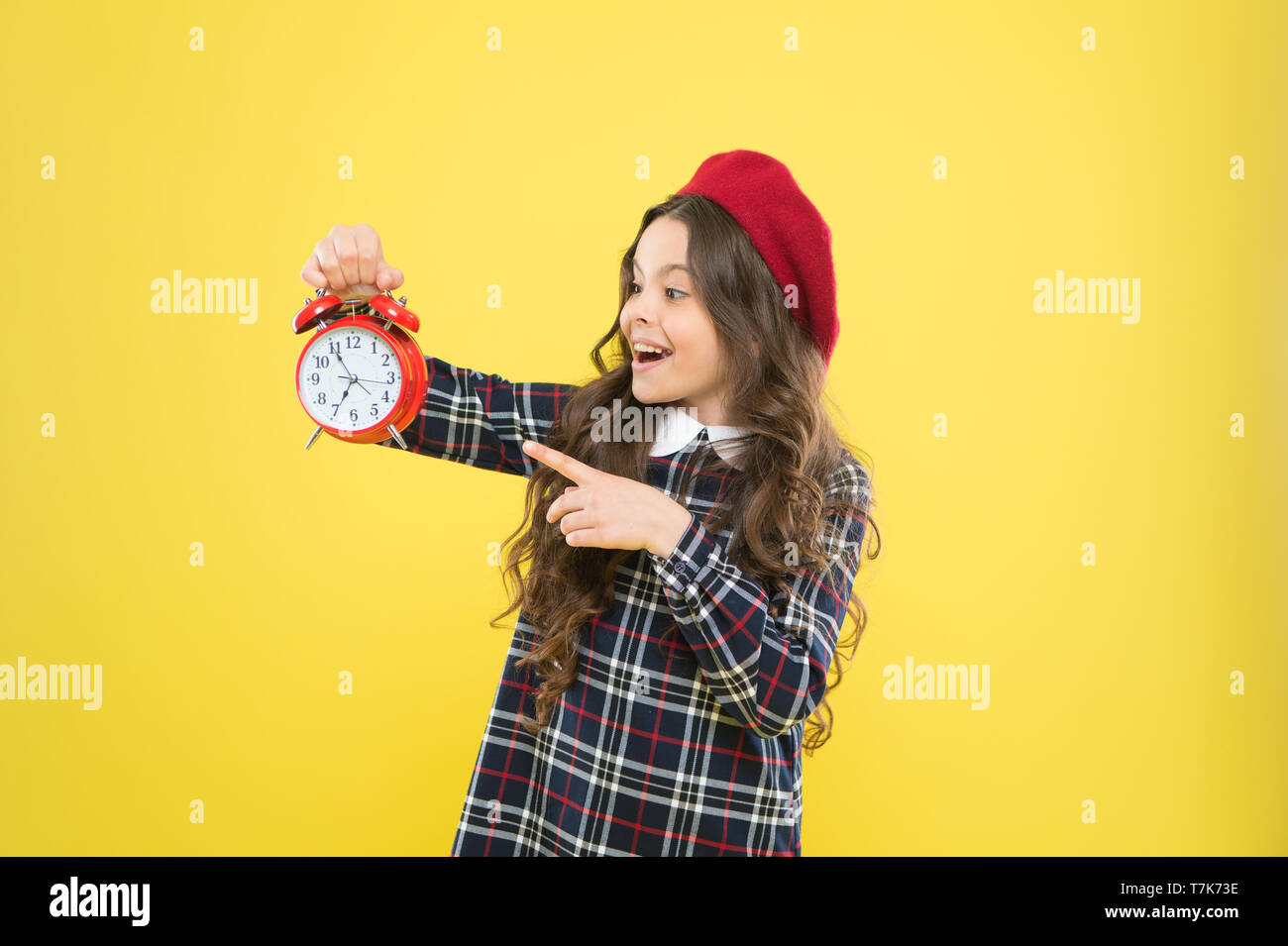 Girl with alarm clock. Set up alarm clock. Child little girl hold red clock. It is time. Always on time. It is never too late. Define your own rhythm of life. Happy hours concept. Schedule and timing. - Stock Image