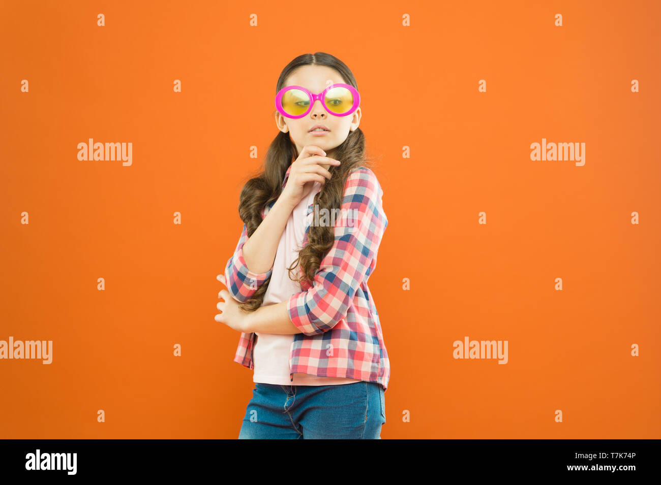UV protection. Optics and eyesight. Child happy good eyesight. Sunglasses summer accessory. Eyesight and eye health. Care eyesight. Ultraviolet protection crucial while polarization more preference. - Stock Image