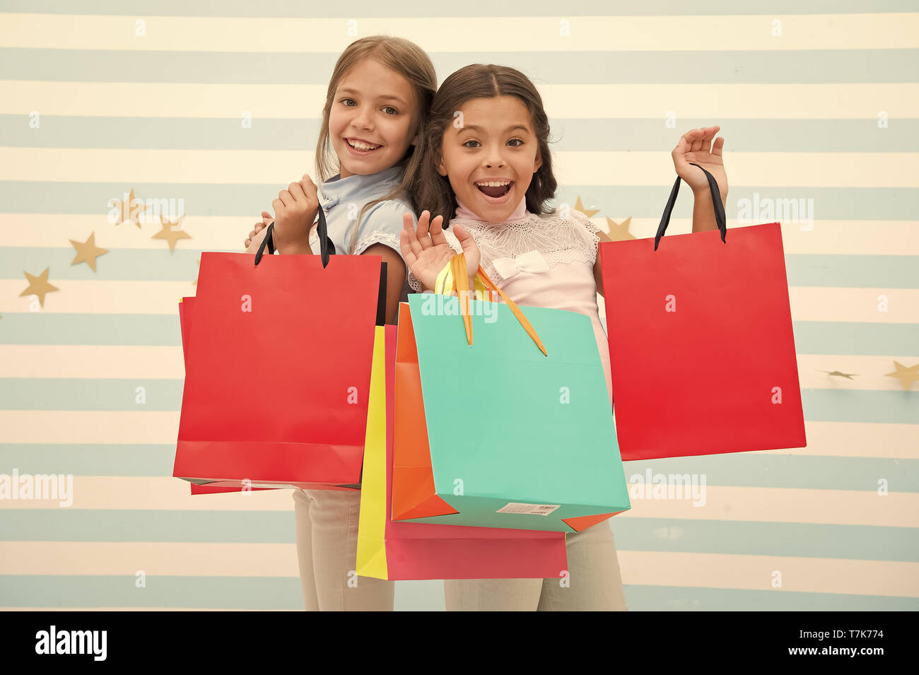sale. happy little girl bought a lot on big sale. little girls on shopping with happy face. go shopping. Best discounts and promo codes - Stock Image