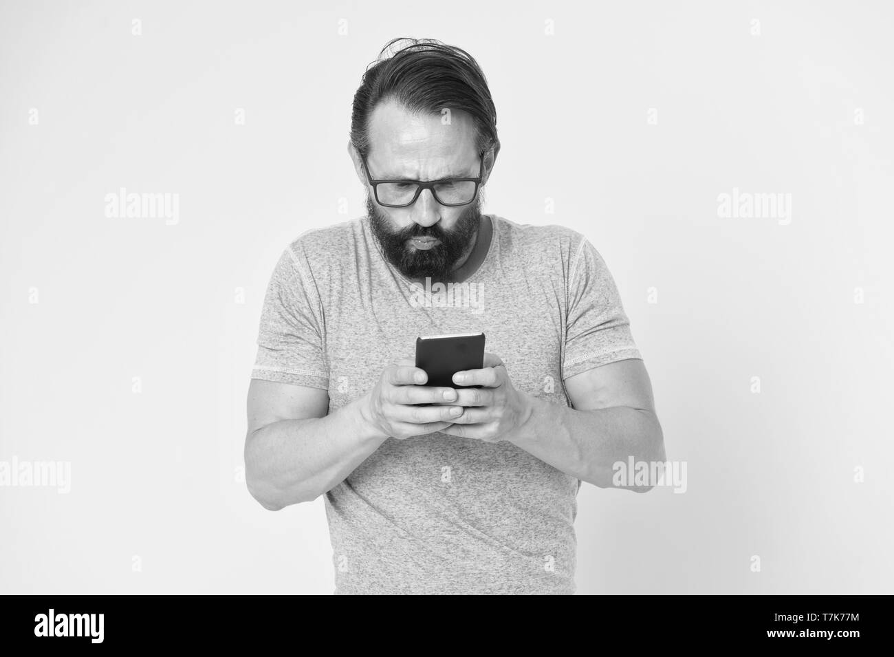 Hipster puzzled use smartphone. Man inexperienced user of modern smartphone. Stay in touch with smartphone. Join online community. User friendly concept. Man puzzled mobile phone opportunities. - Stock Image