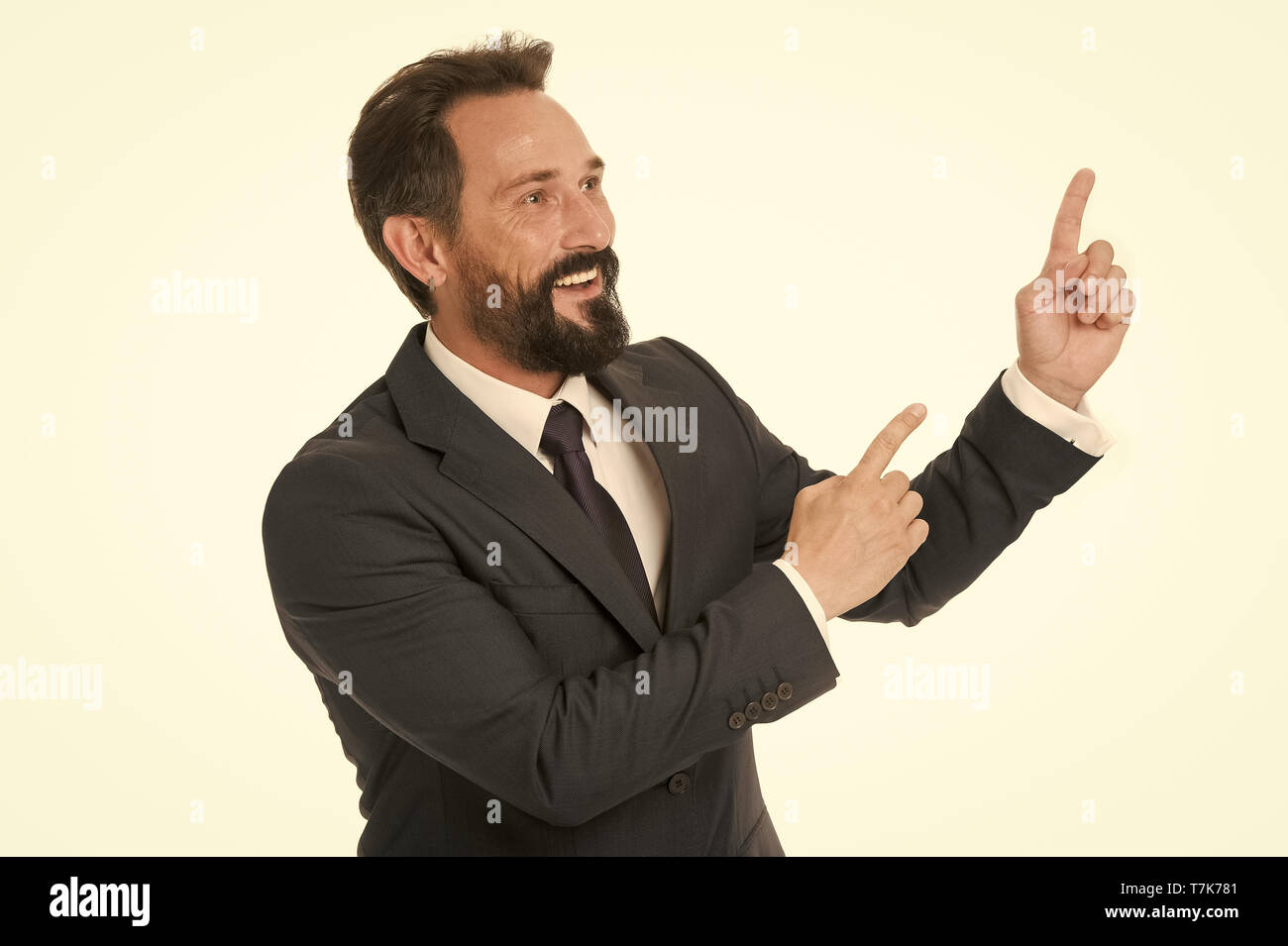 Pointing direction. Man pointing index fingers isolated on white. Man bearded mature in formal wear. Businessman or manager with beard and mustache shows direction. Look at that advertisement. - Stock Image