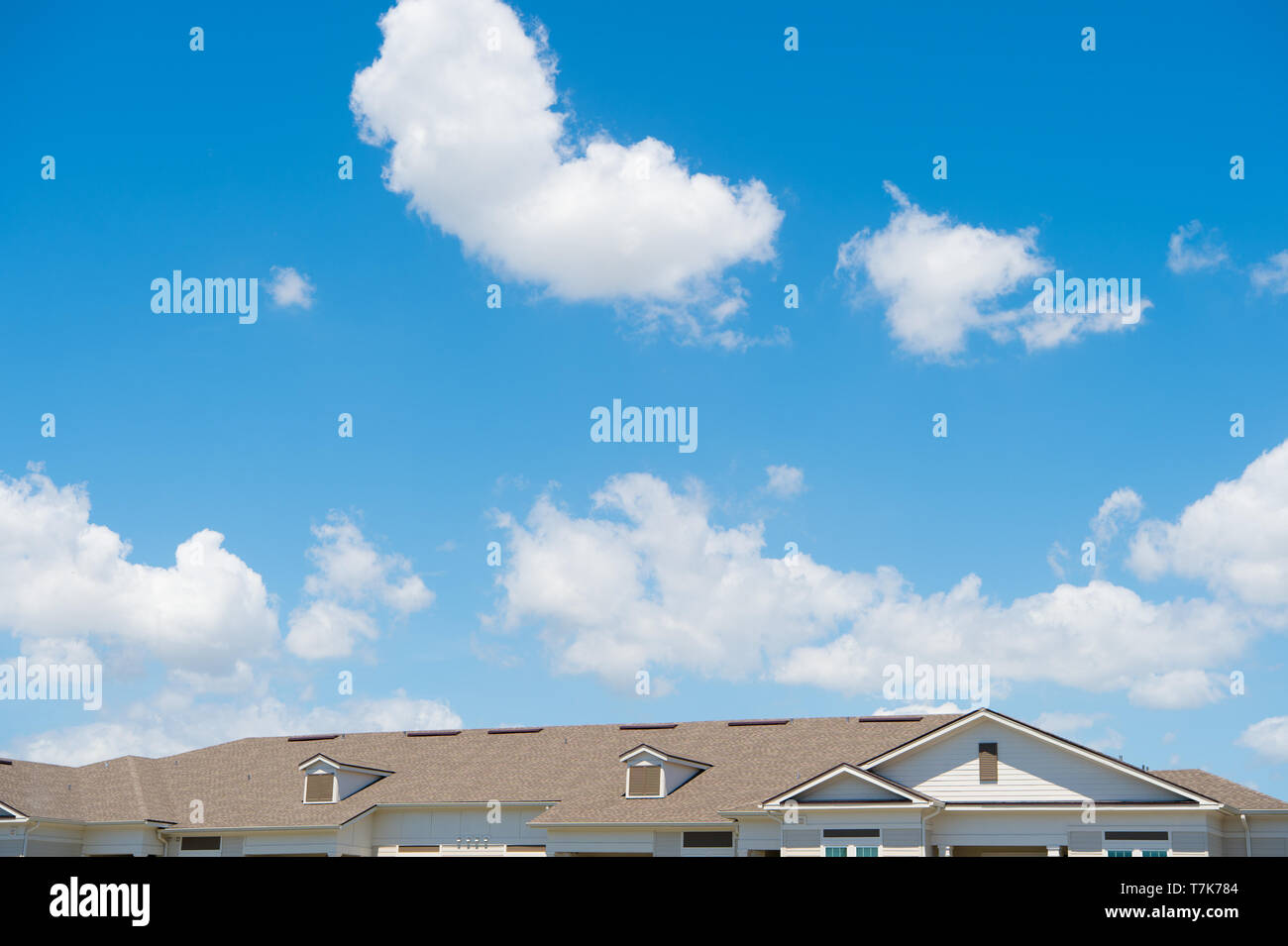 House Roof On Blue Sunny Sky Background Architecture And Structure Design Concept Rent An Apartment Relocation Moving To A New House Rooftop Protection And Shelter Promoting Safety For Life Stock Photo