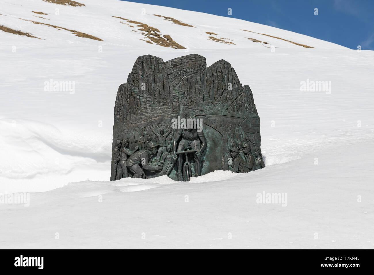 Fausto Coppi memorial at Passo Pordoi covered in snow - Pordoi Pass, Dolomites, Italy - Stock Image