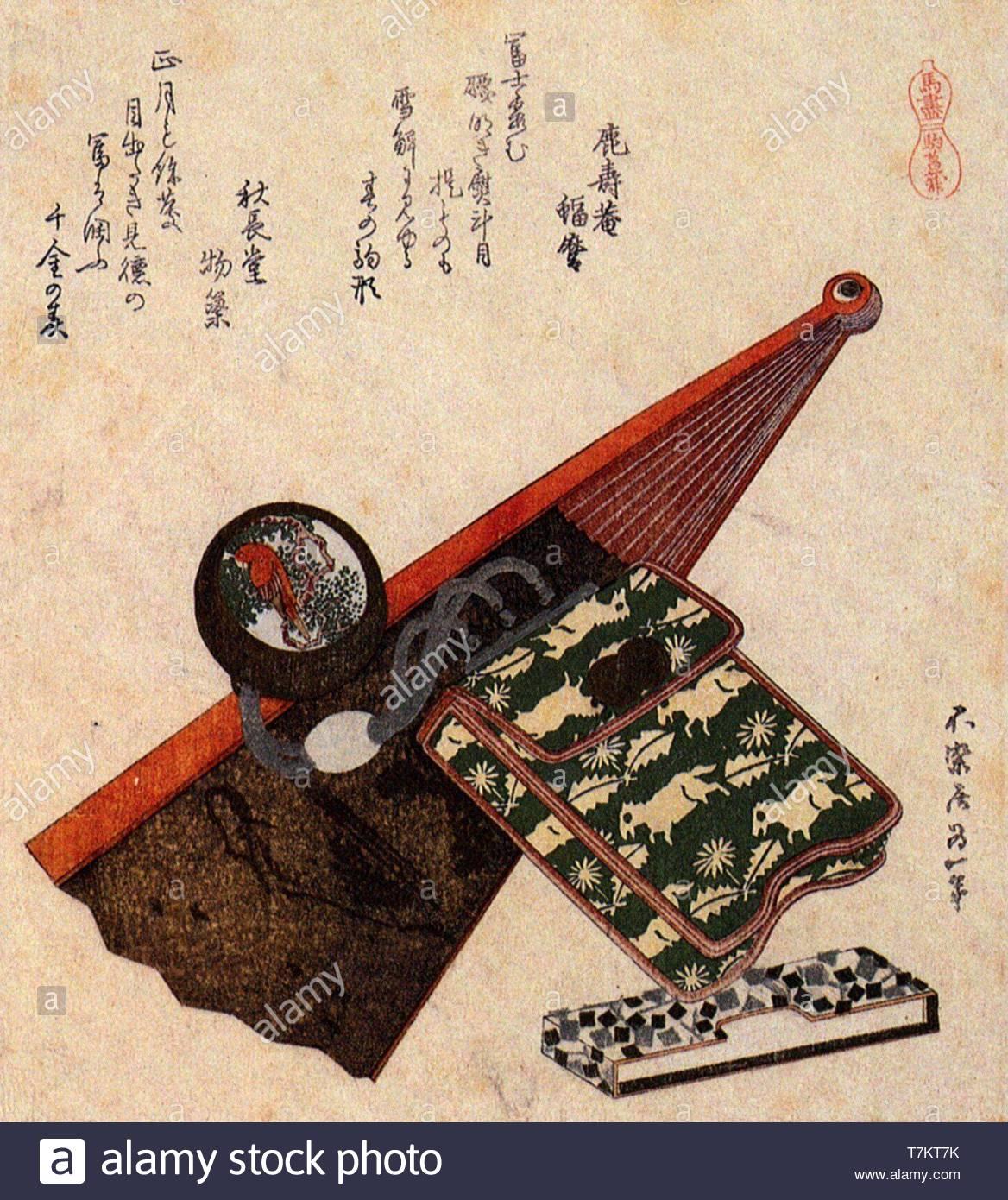 Katsushika-Hokusai-A leather Pouch with kagami Netsuke ona partly opened fan - Stock Image