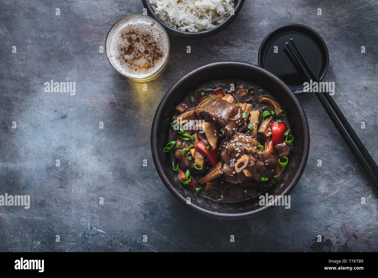 Asian lamb stew in a pot, top view copy space - Stock Image