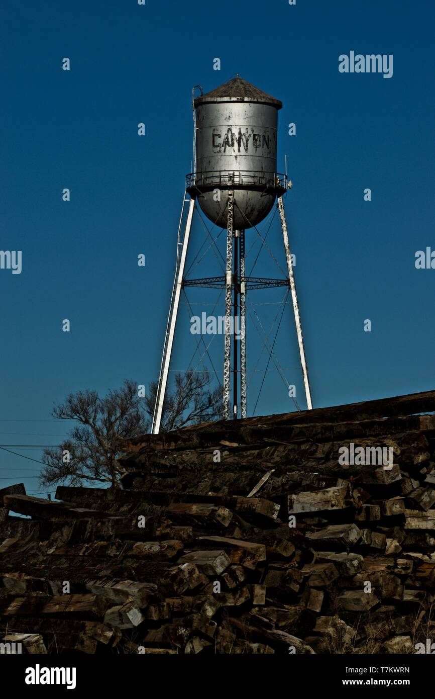 City of Canyon Original Water Pressure Tower with Railroad Track Post Pile, near Old Canyon Rail Road Station, Canyon, Texas. - Stock Image