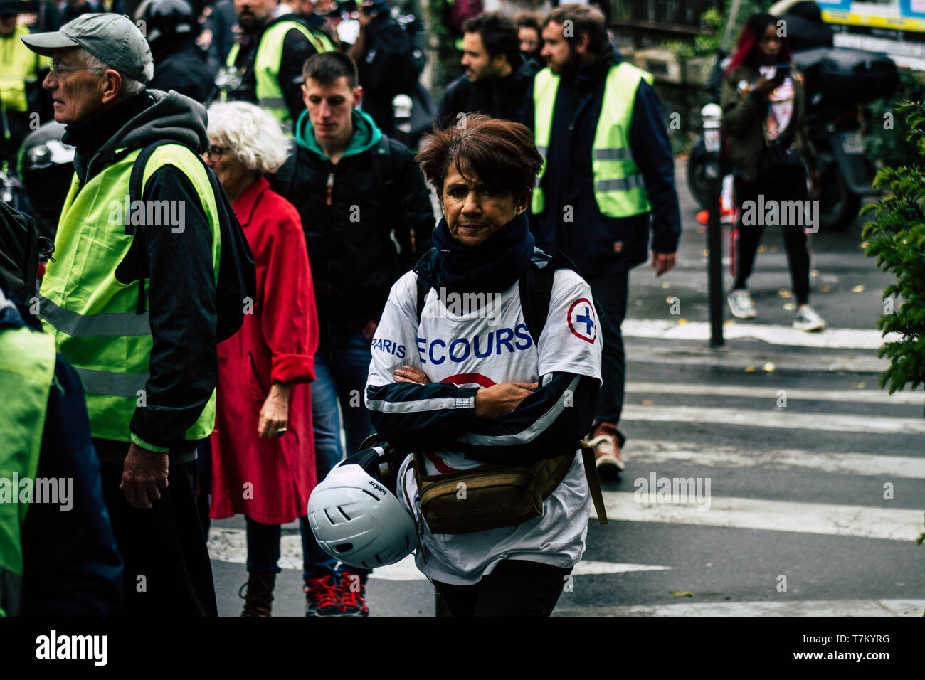 Paris France May 04, 2019 View of French street medic walking in the street during protests of the Yellow jackets Stock Photo