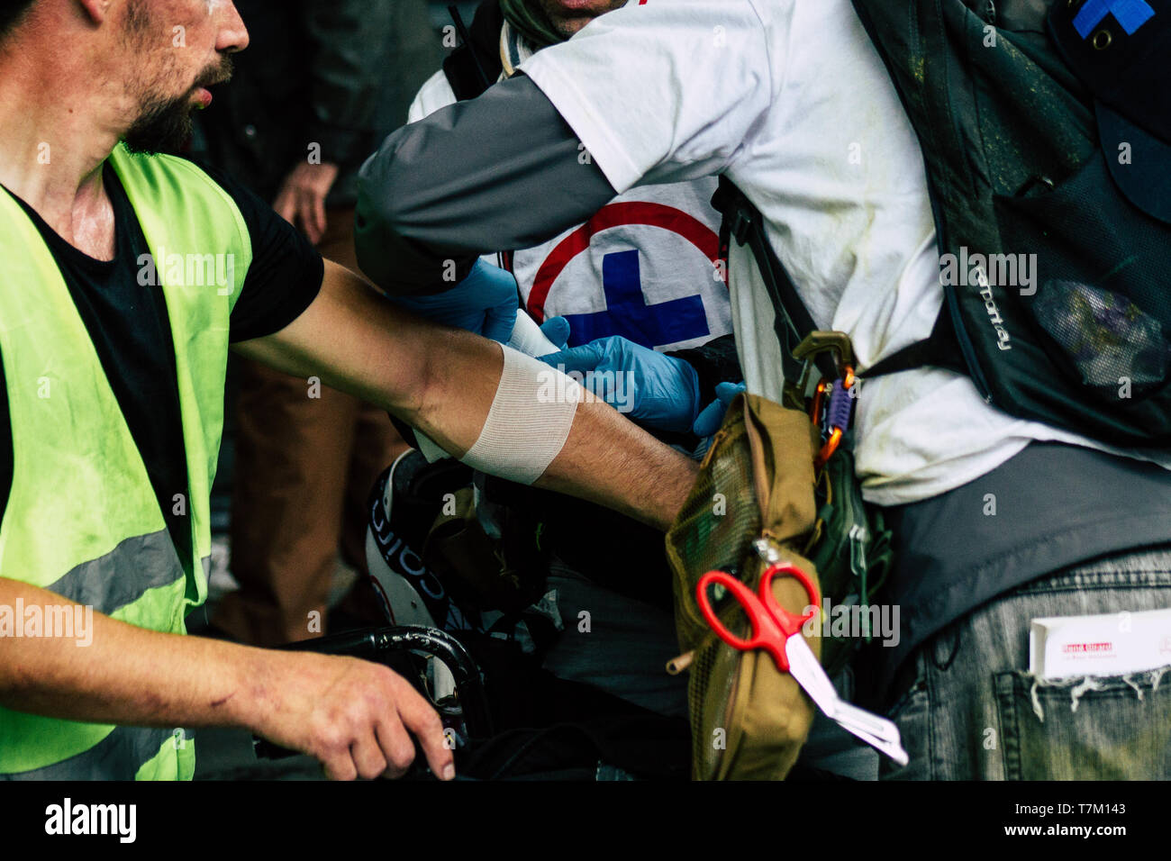 Paris France May 04, 2019 View of French street medic helping a protester injured by the riot squad of the French National Police in the street during Stock Photo