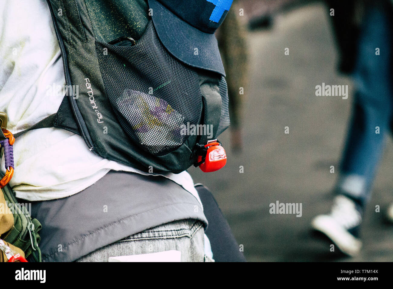 Paris France May 04, 2019 View of French street medic helping a protester injured by the riot squad of the French National Police in the street during - Stock Image