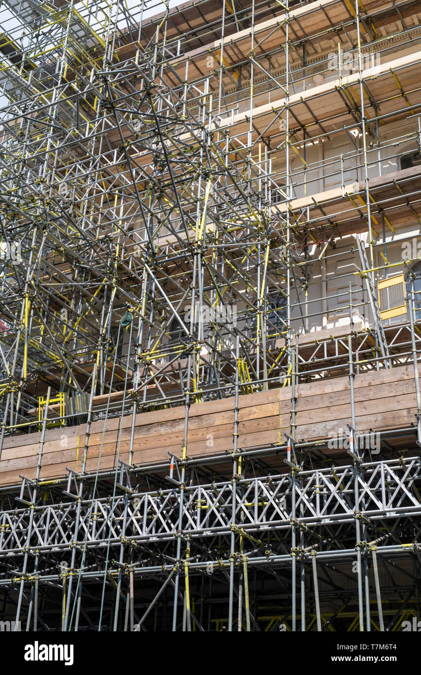 Scaffolding on a house. Ennismore Gardens Mews, South Kensington, City of Westminster, London. England - Stock Image