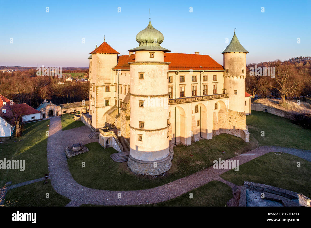 Poland. Renaissance, partly Baroque Castle on the hill in Nowy Wiśnicz. Presently owned by Polish state. Aerial view in spring. Sunset light. - Stock Image