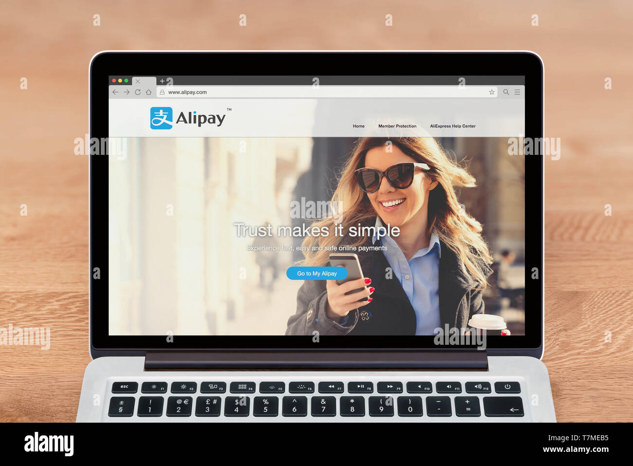 An Apple Macbook displays the Alipay website (Editorial use only). - Stock Image