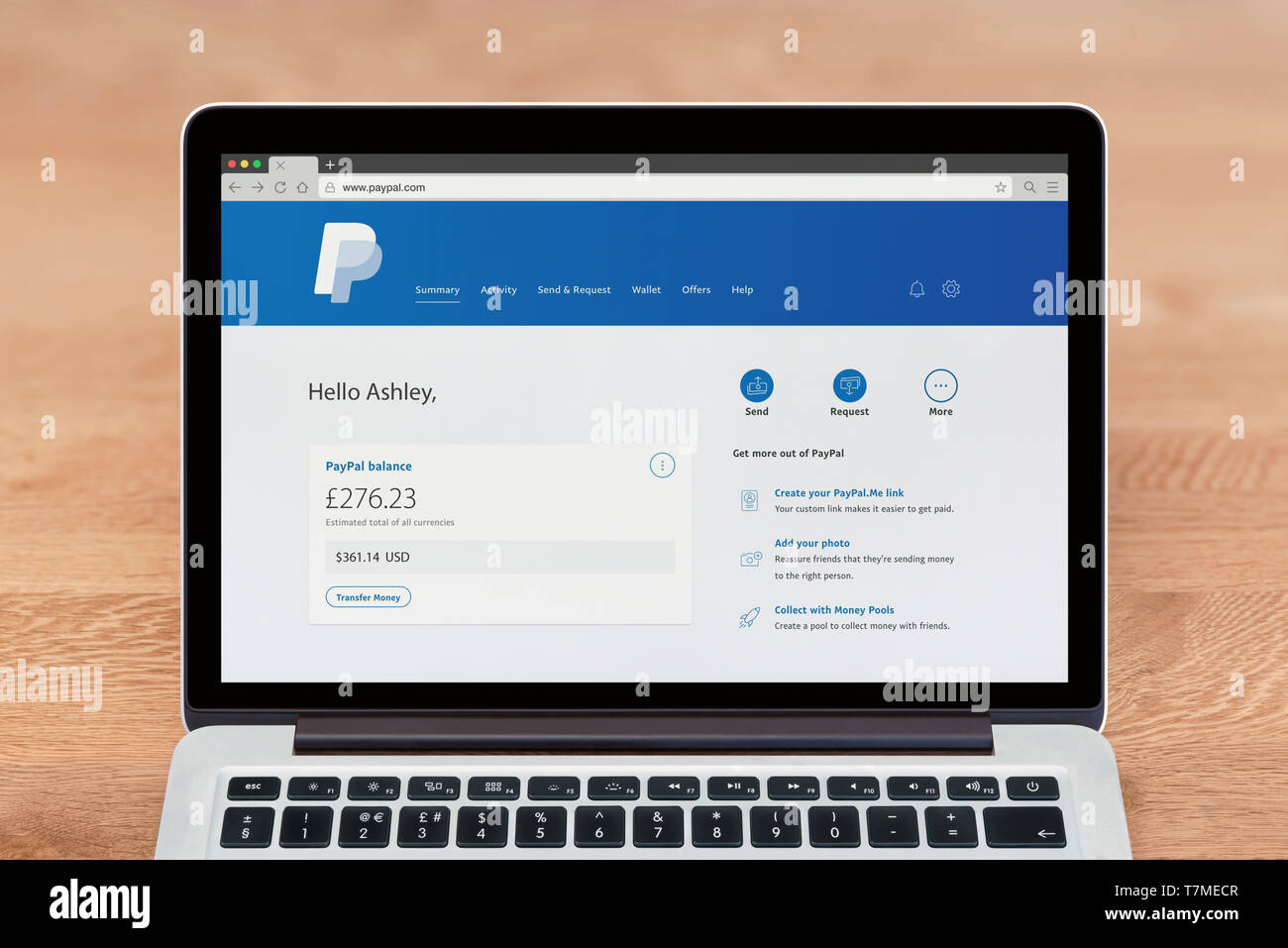 An Apple Macbook displays the Paypal website (Editorial use only). - Stock Image