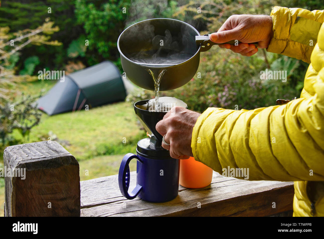 Brewing coffee at the campsite at Pumalin National Park, Patagonia, Region de los Lagos, Chile - Stock Image