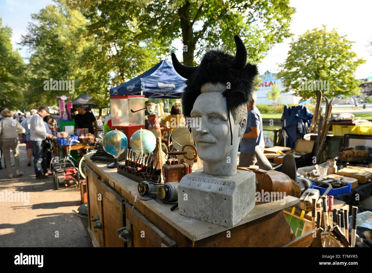 France, Nord, Lille, 2017 clearance sale, second-hand dealers along the esplanade, sculpture of a mustachioed man's head surmounted by horns in a moumoute - Stock Image
