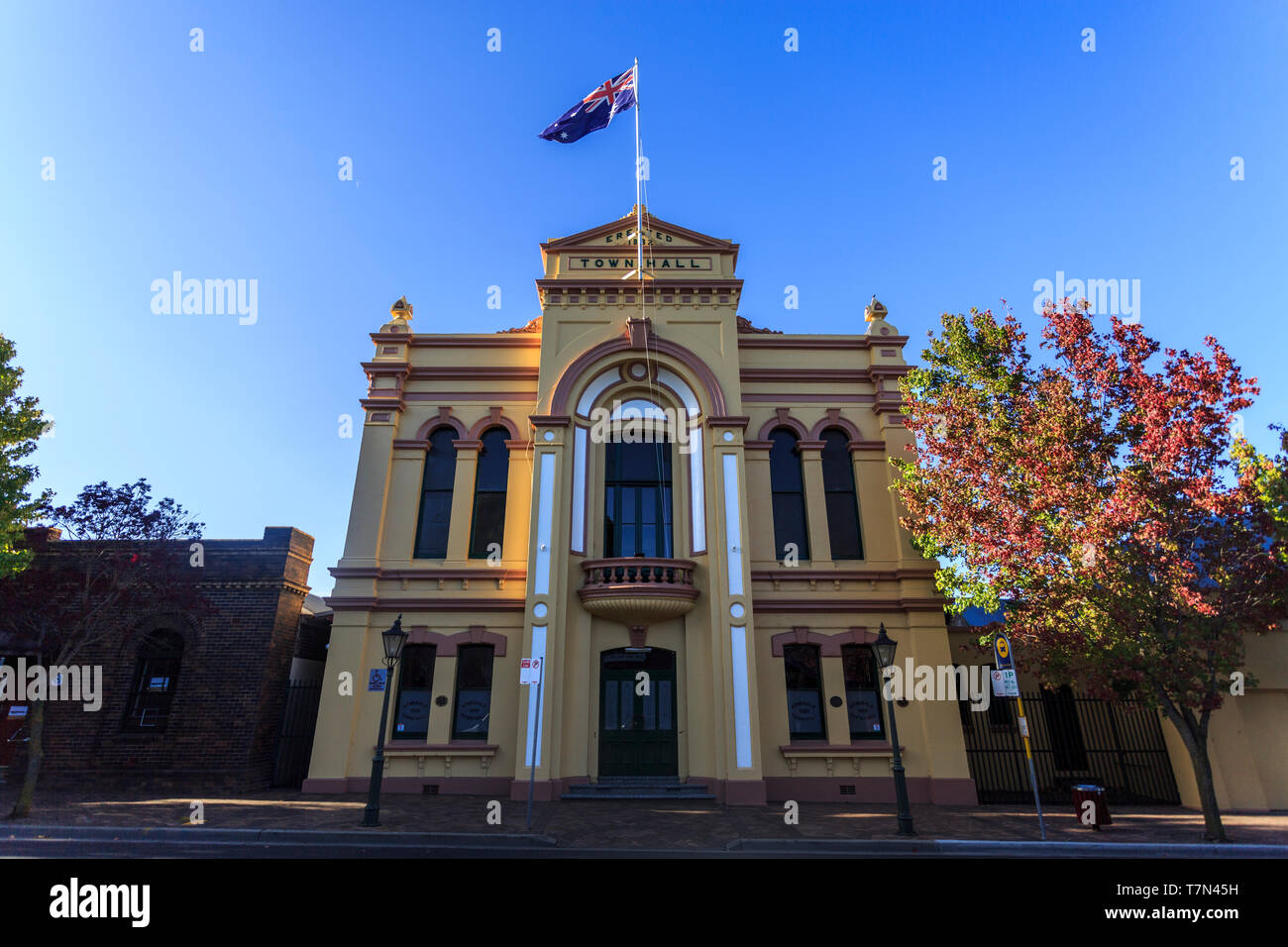 View of the ostentatious Town Hall, a two-storey High Victorian building completed in 1882 with a stuccoed brick facade including pilasters, scrolls,  - Stock Image