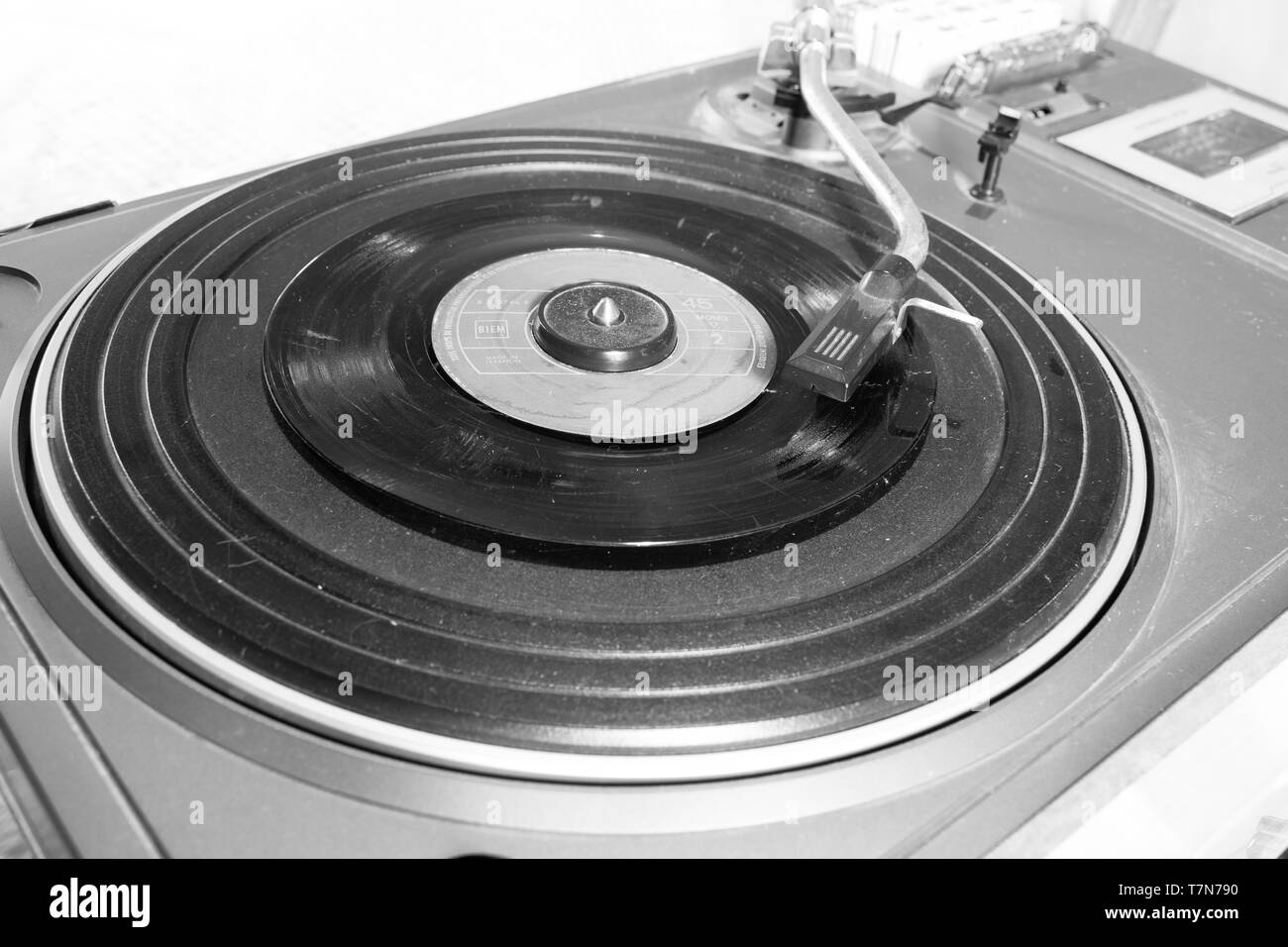 This is and old and antique turntable captured in black and white and you can see the scratches and old material of the player Stock Photo