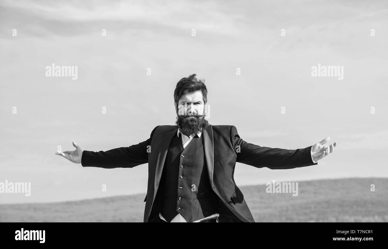 Self proud and narcissistic. Hipster bearded attractive enjoy freedom. Guy enjoy top achievement. Man bearded proud himself sky background. Superiority and power. Feeling undefeated. Proud of himself. - Stock Image