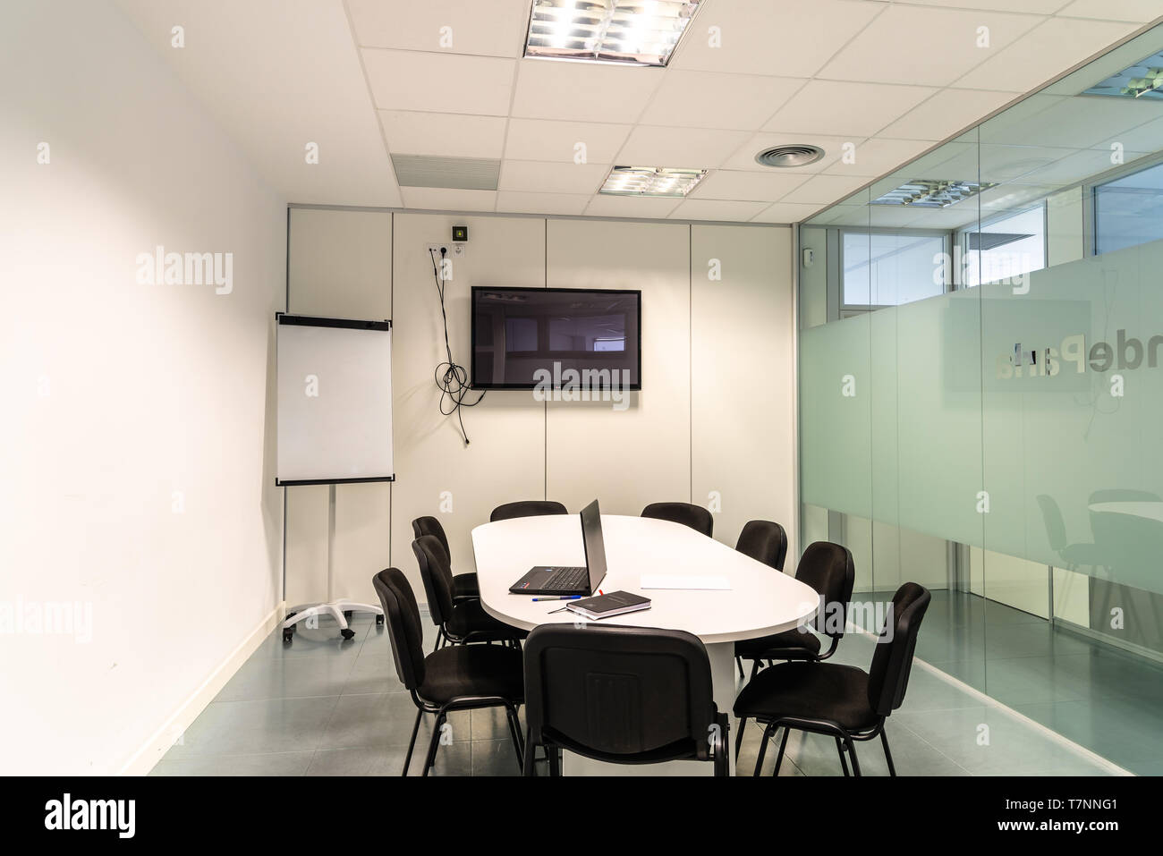 Modern conference room with furniture tv and whiteboard. Stock Photo