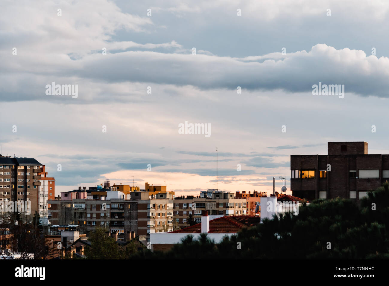 Cityscape of residential district of Madrid against cloudy sky at sunset. Ciudad Lineal, Madrid, Spain Stock Photo