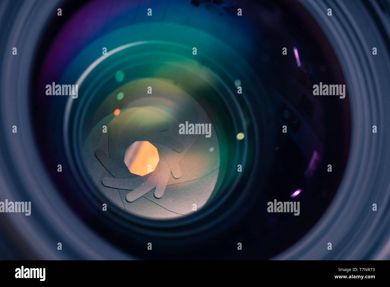 Detail picture of camera lens anti reflective coating, casting green and purple reflections, detail of aperture inside of a lens - Stock Image