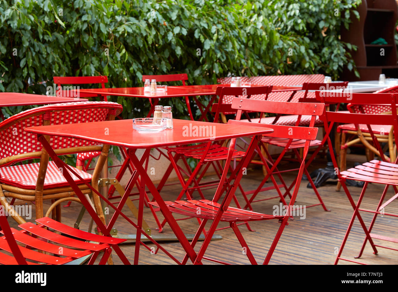 Restaurant red outdoor tables and chairs in summer, nobody Stock Photo