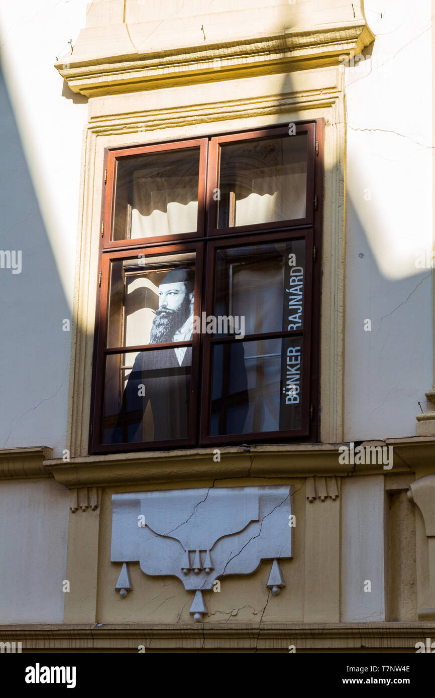 Life-size photo of Bünker Rajnárd ethnographer looking out of a window of Stornó ház (Storno House), Museum in Sopron, Hungary - Stock Image