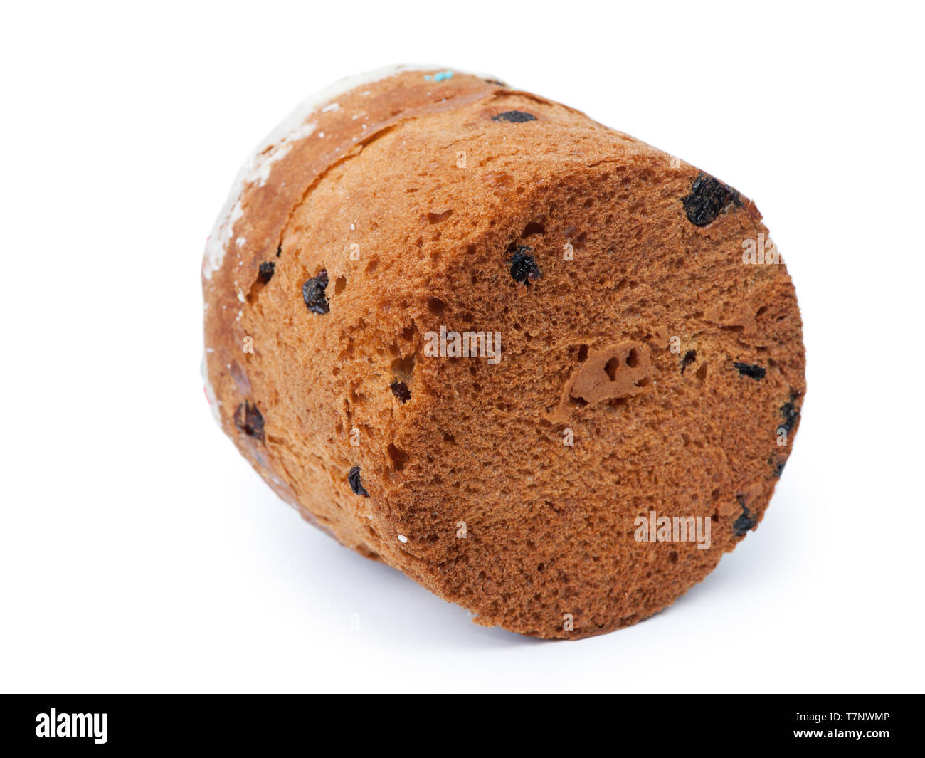 Easter cake with raisins and white cap made of icing and colored powder isolated on white background. Traditional Russian festive homemade bread for c - Stock Image
