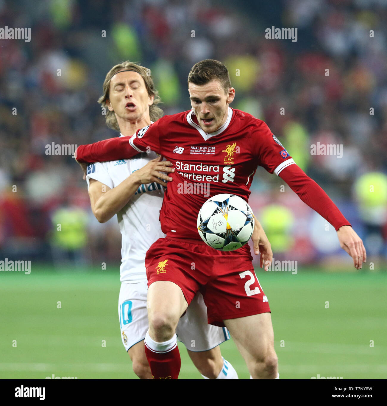 Andy Robertson of Liverpool (R) fights for a ball with Luka Modric of Real Madrid during their UEFA Champions League Final 2018 - Stock Image