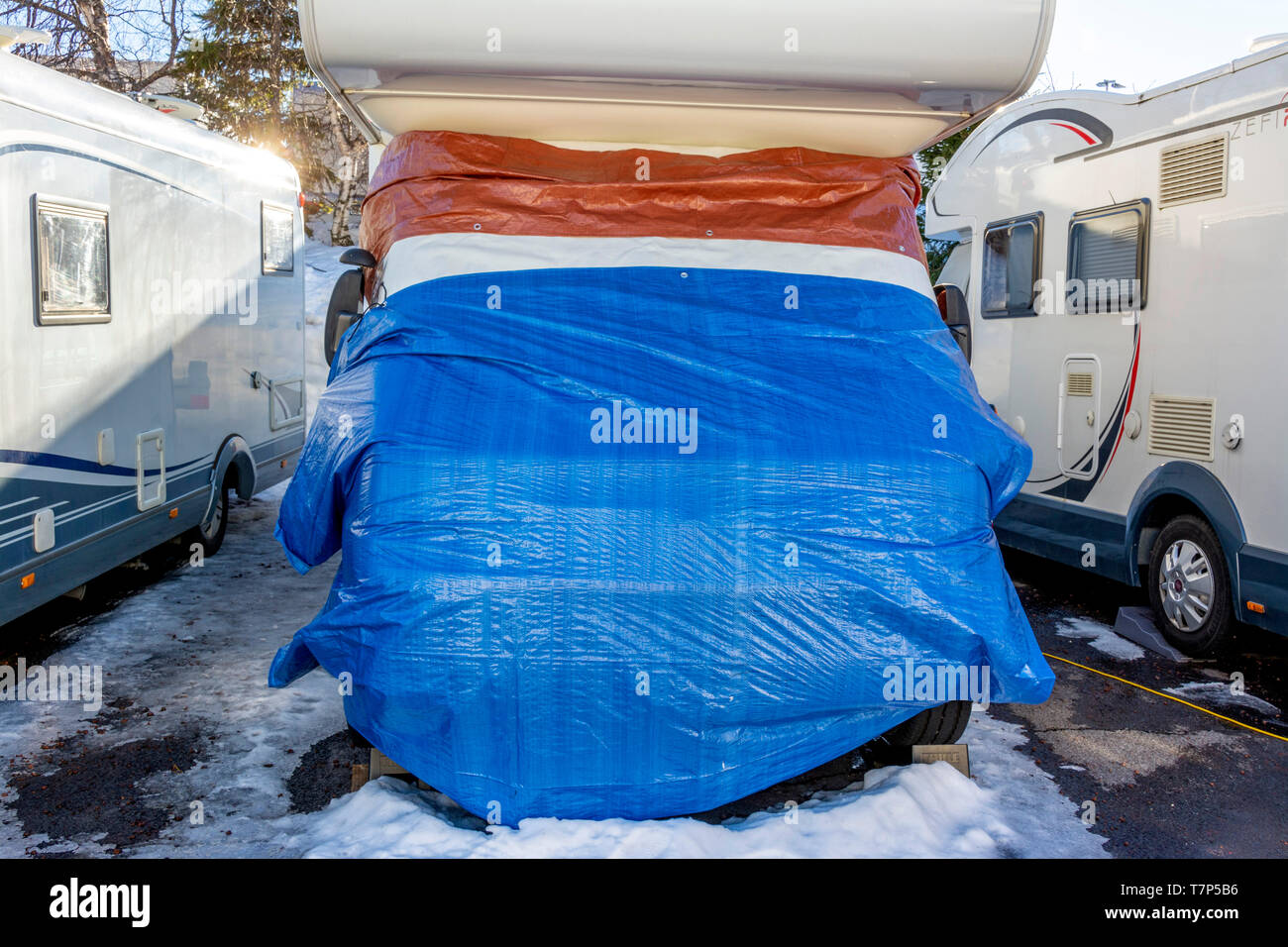 Mobile home protection in winter, France - Stock Image