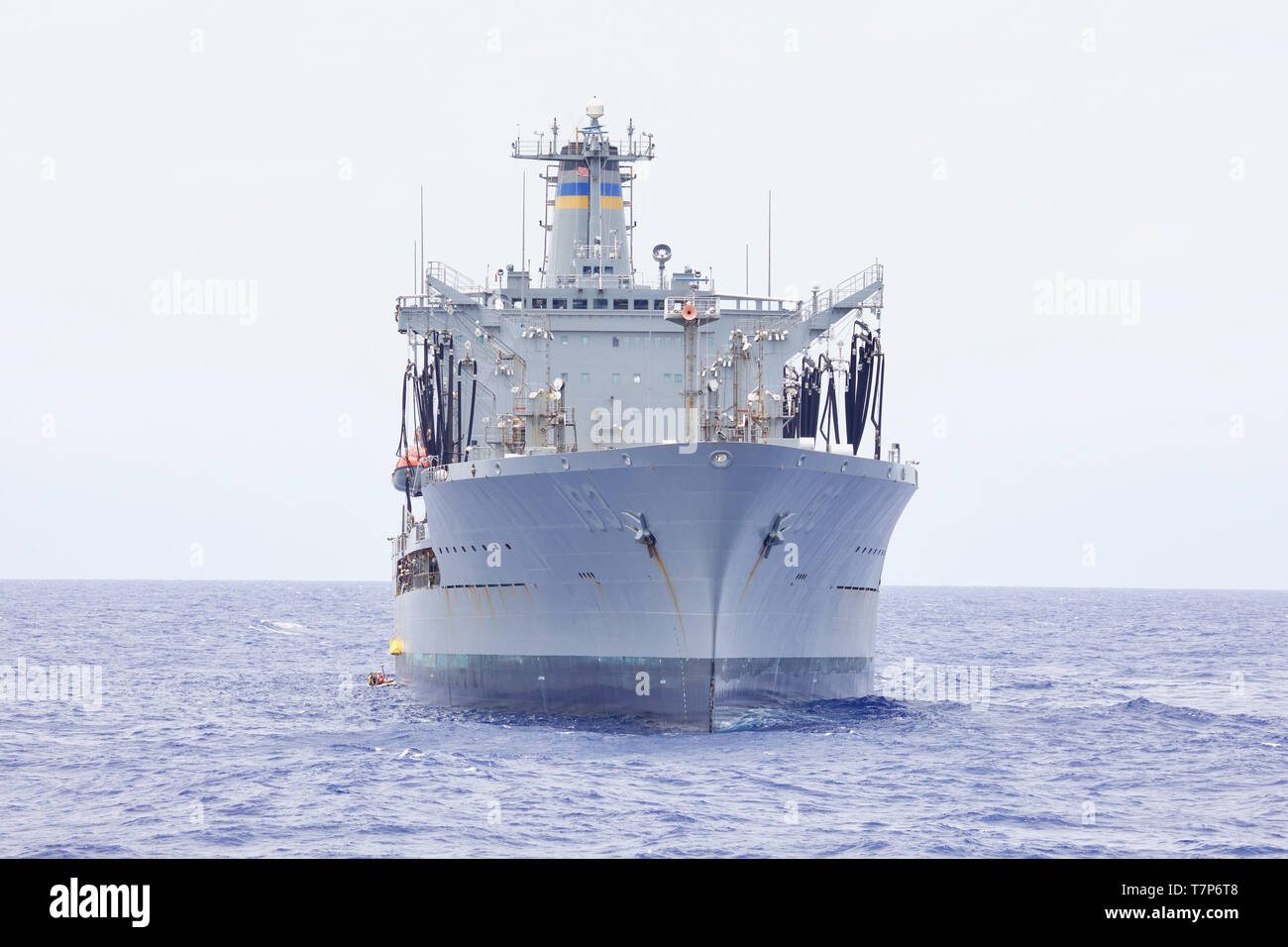 190505-N-AD347-1008 South China Sea (May 5, 2019)   Sailors from the the Avenger-class mine countermeasures ship USS Pioneer (MCM 9) wait along side the fleet replenishment oiler USNS Walter S. Diehl (T-AO 193) for cargo during a replenishment-at-sea. Pioneer, part of Mine Countermeasures Squadron 7, is operating in the U.S. 7th Fleet area of operations to enhance interoperability with partners and serve as a ready-response platform for contingency operations. (U.S. Navy photo by Lt. j.g. Alexander Fairbanks) - Stock Image