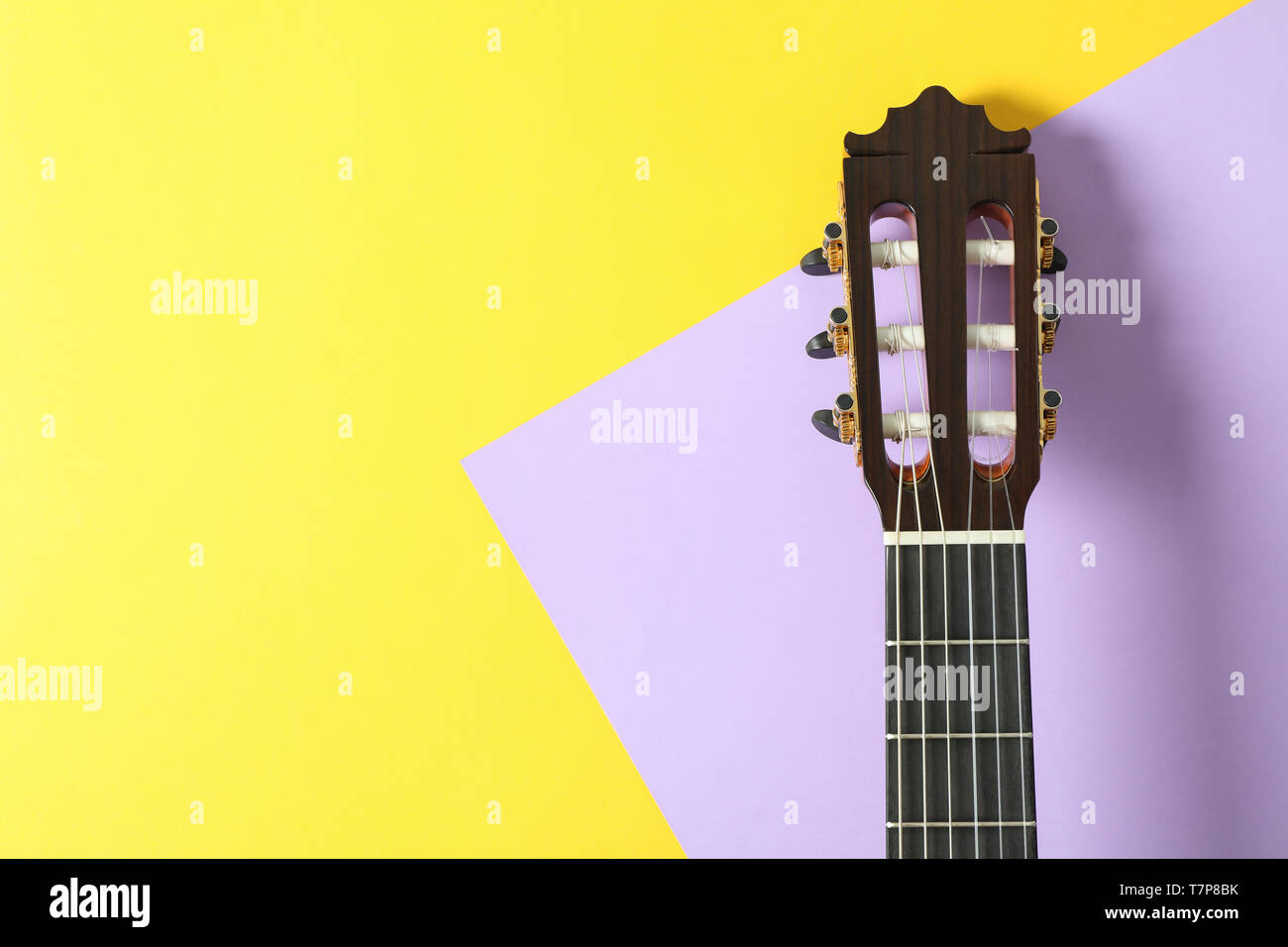Guitar neck on two tone background, space for text Stock Photo