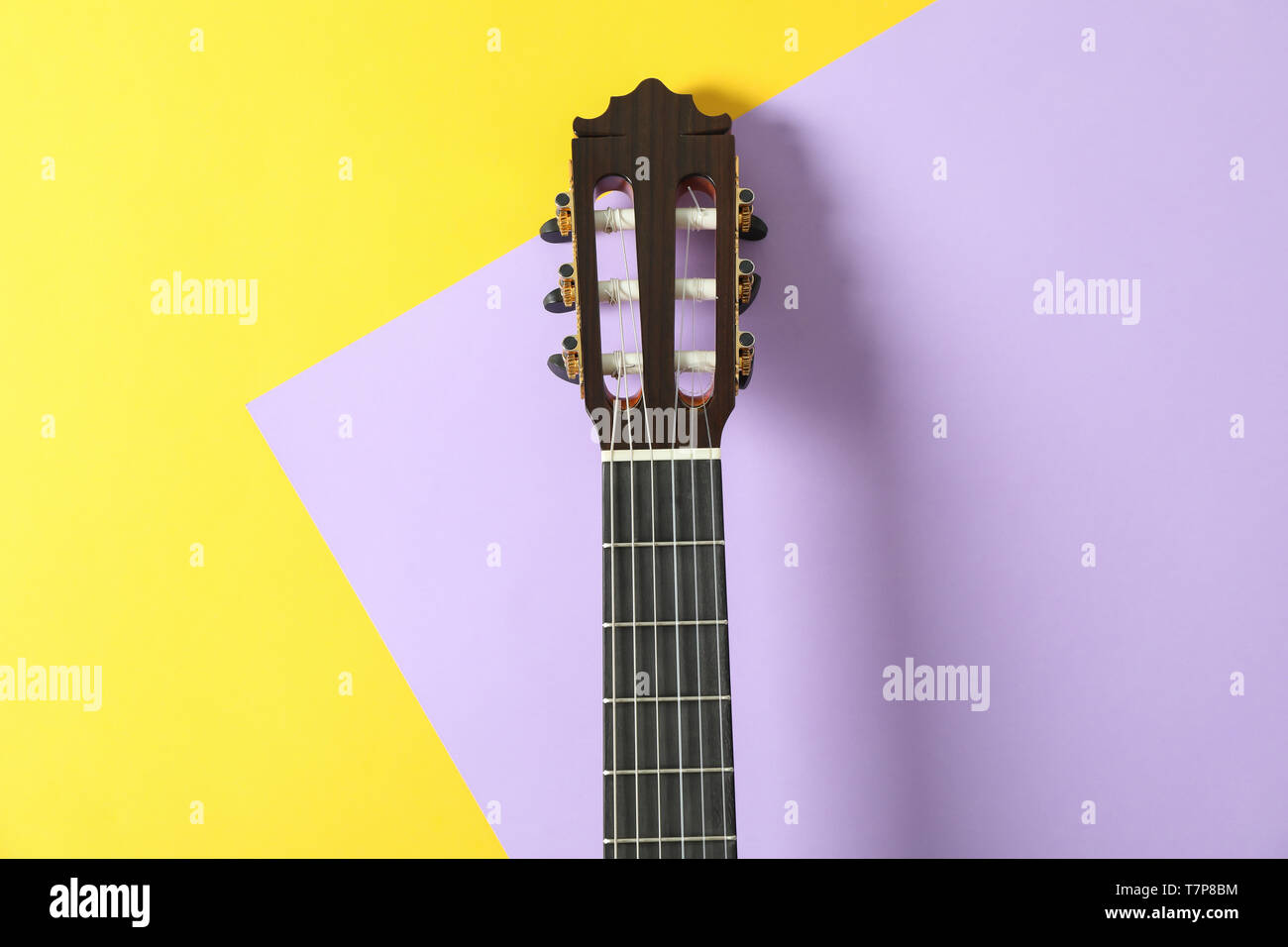 Guitar neck on two tone background, space for text - Stock Image
