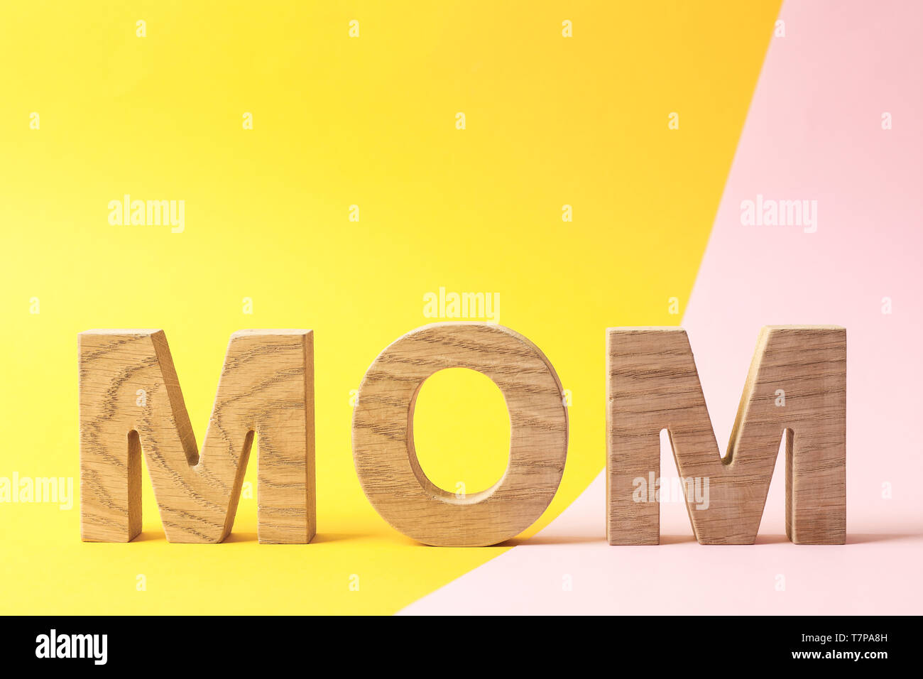 Inscription mom on two tone background, space for text - Stock Image